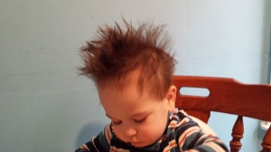 This is what happens when you allow a 16 month old to feed himself so that you can simultaneously clean the house, attend a conference call, and exercise:  food becomes hair styling product.