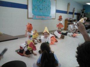 Brady not participating (glaring):  Preschool concert, spring 2013